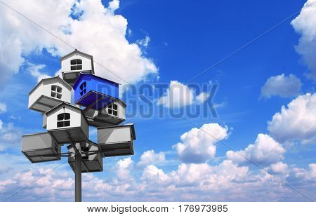 Many nesting boxes of gray color and single nesting box of blue color. On background with blue sky and white clouds