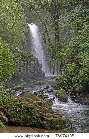 Foggy Templo Waterfall in the La Paz Waterfall Gardens in Costa Rica