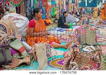 Kolkata West Bengal India - 28th November 2015 : Woman hand weaving jute bags handicrafts on display during the Handicraft Fair in Kolkata. Biggest handicrafts fair in Asia.