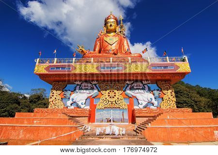Samdruptse statue a huge buddhist memorial statue in Sikkim blue cloudy sky in background.