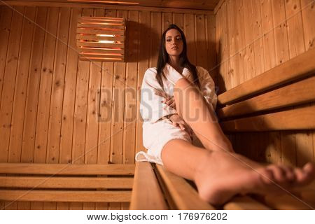 portrait of Beautiful woman relaxing in sauna and staying healthy