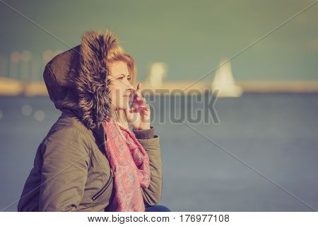Woman Relaxing On Beach, Cold Day