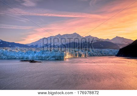 Sunrise at Hubbard Glacier Alaska. View from the ship.