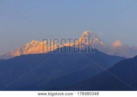 Annapurna One and Annapurna South mountain with sunset view from Gorepani famous trekking destination in Nepal.