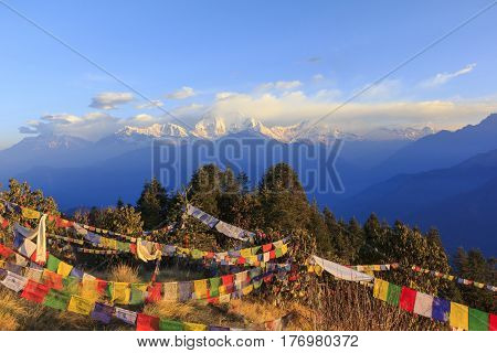 Annapurna and Himalaya mountain range with sunrise view from Poonhill famous trekking destination in Nepal. poster