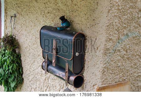 Funny Mailbox Looks Like School Bag On House Wall At Hallstatt