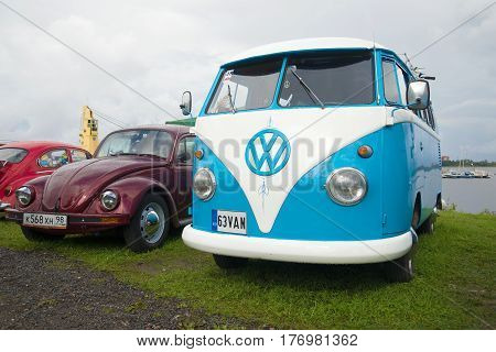 SAINT PETERSBURG, RUSSIA - SEPTEMBER 04, 2016: Minibus Volkswagen T1 Kombi 1950-ies and Volkswagen Beetle on the festival of retro cars in Kronstadt