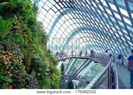 Singapore, Singapore - February 12, 2017: People walk in the Gardens by the Bay Cloud forest pavillion on February day in Singapore.