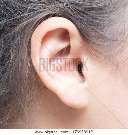 close up shot of a woman ear