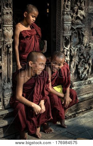 Myanmar Three novice joyful and smiling with friends in pagoda at Mandalay myanmar