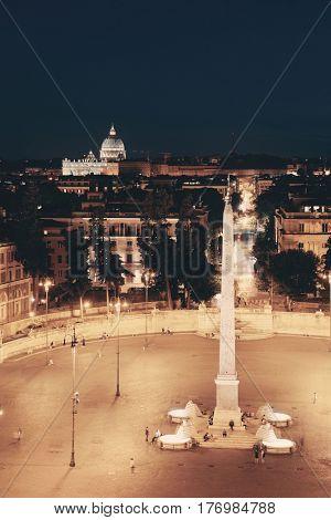 Piazza del Popolo at night in Rome, Italy.