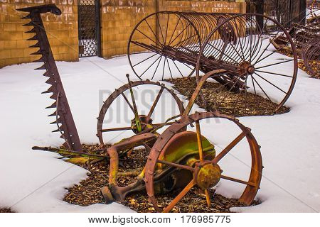 Vintage Grass Mowing Farm Equipment On Display In Winter