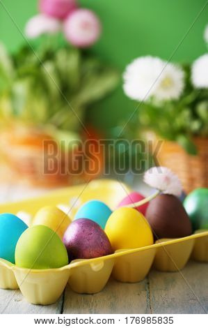 Multicolored eggs with flowers. Easter conceptual background