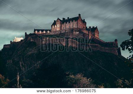 Edinburgh castle with fountain as the famous city landmark. United Kingdom.