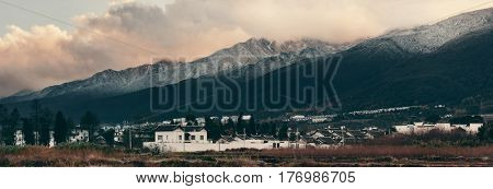 Dali old town rooftop view with snow capped Mt Cangshan. Yunnan, China.