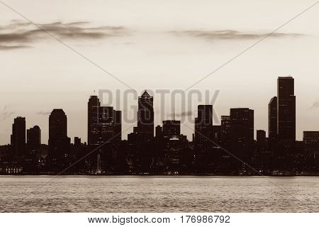 Seattle sunrise skyline silhouette view with urban office buildings.