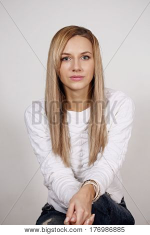 Portrait of beautiful sad woman with blond hair