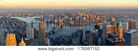 Manhattan downtown sunset rooftop panorama view with urban skyscrapers in New York City