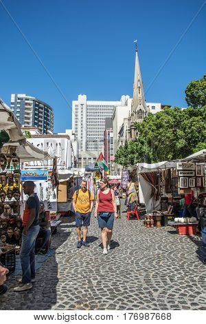 Cape Town South Africa - March 02 2017: Tourists strolling though the fleamarket at Greenmarket square in Cape Town.
