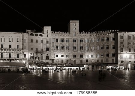 Old buildings in Piazza del Campo night view in Siena, Italy.