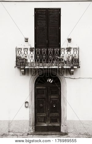 Vintage door and balcony closeup in medieval Town Lucca in Italy.