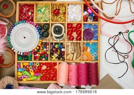 embroidery and sewing accessories top view, seamstress workplace, many object for needlework, handmade and handicraft