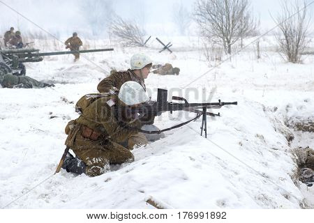 SAINT PETERSBURG, RUSSIA - JANUARY 15, 2017: the Soviet machine gunners with a machine gun in battle. A fragment of the military-historical festival for the release of the Krasnoe Selo. Operation