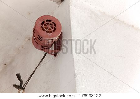 Alarm sound or siren sound. Old vintage style make a sound siren by rotating the rotor with an electric motor for security system. Ancient style installed on concrete