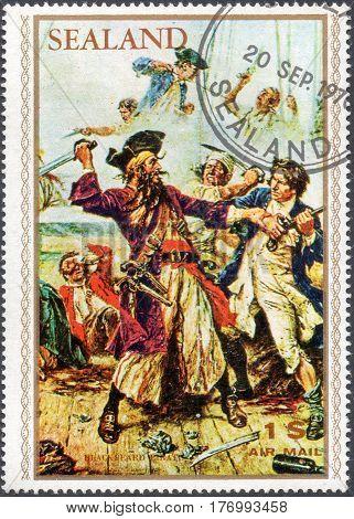UKRAINE - CIRCA 2017: A stamp printed by Sealand shows pirate Edward Teach Blackbeard pirate attack circa 1970