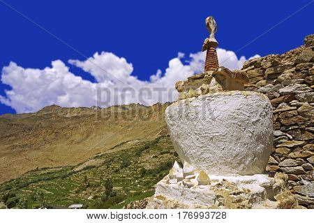 Ancient Buddhist Stupa in the High-Altitude Mountain Desert near the village of Nako, Spiti Valley, Northern India.
