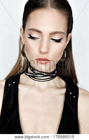 Punk Rock Style. Fashion Woman Model Face With Glamour Makeup. P