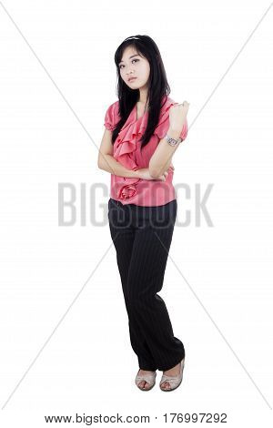 Full length of arrogant businesswoman standing in the studio isolated on white background
