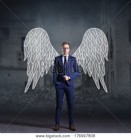 Business angel standing on apocalyptic background. Crisis, default, setback concept.
