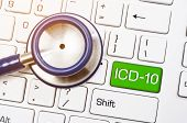 International Classification of Diseases and Related Health Problem 10th Revision or ICD-10 and stethoscope medical on computer keyboard. poster