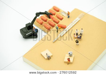Miniature People Consult A Doctor To Ask For Health Problems. Annual Health Check Or Consult A Docto