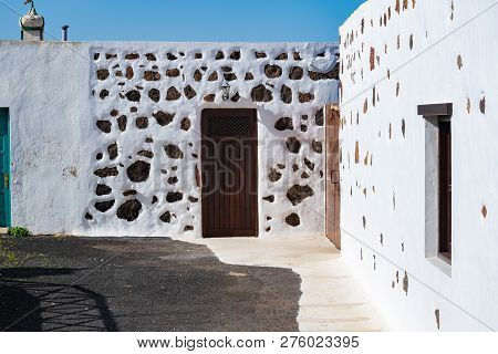 Typical White Architecure Of The Ye Village Under Volcano Monte Corona, Lanzarote, Canary Islands, S