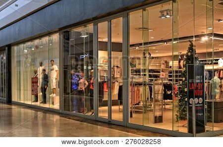 Shop Window. Fashion Storefront In A Large Shopping Mall. Guess. Global Lifestyle Brand For Women An
