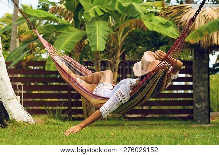 Beautiful Woman Relaxing In Hammock. Beautiful Woman Sleeping In Hammock. Happy Beautiful Woman In W