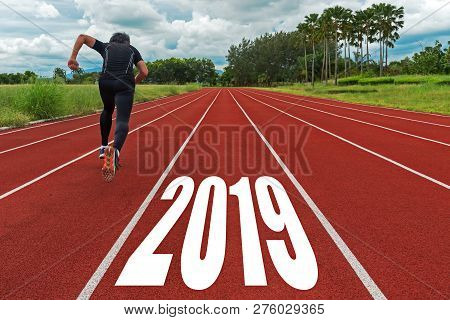 The Start Into The New Year 2019. Start Up Of Runner Man Running On Race Track Go To Goal Of Success