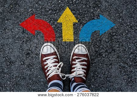 Man With A Shoes Are Standing Next To Colorful Three Direction Arrow Choices, Left, Right Or Move Fo