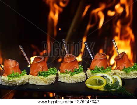 Sandwich With Salmon As Appetizer Or Starter. Tasty Small Sandwich With Bread And Redfish Fish. The