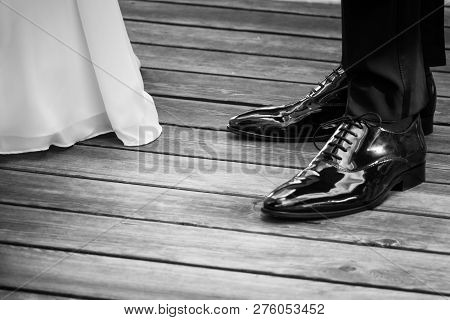 Wedding Bride And Groom Standing Next Each Other At Marriage. The Man And The Woman Wearing Luxury L