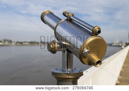 The Image Shows A Telescope At A Panoramic Point