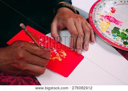 Ho Chi Minh City, Vietnam 01-2018: Vietnamese Scholar Writes Calligraphy At Lunar New Year. Calligra