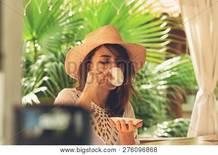 Beautiful Woman Drinking Coffee. Healthy People Lifestyle. Woman Relaxing In Coffee Place. .vacation