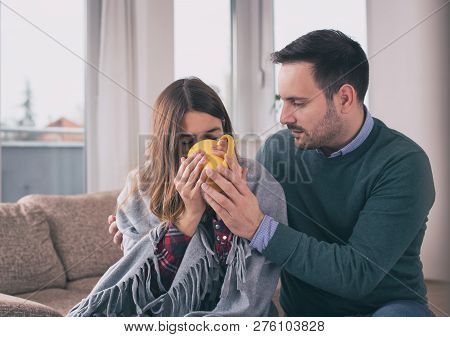 Girl Having Flu And Boyfriend Taking Care Of Her