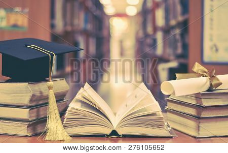 Education Success With Graduation Hat, Academic Cap, Mortarboard, And Degree Certificate On Books An