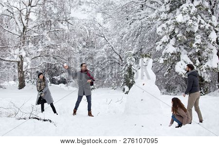 Friends Having Snowball Fight