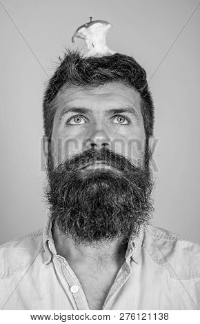 Man Handsome Hipster Long Beard Almost Eaten Apple Stump On Head As Target. Hipster Surprised Face W