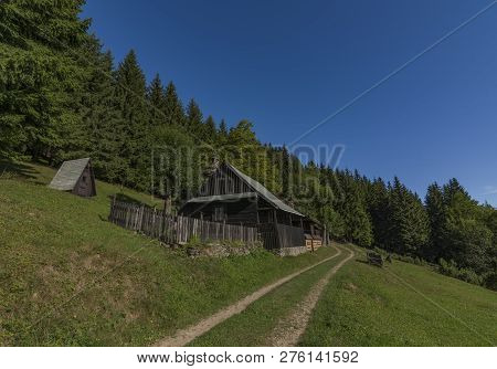 Wooden Cottage In Summer Hot Color Blue Sky Morning In Javorniky Mountains